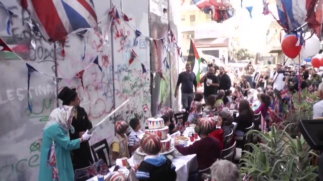 Secretive British street artist Banksy held a special event Wednesday to apologise for the 100th anniversary of the Balfour Declaration outside his...