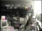 / security camera footage of burglar with bag over his head enters Radio Shack store and falls down as he becomes disoriented because he cannot see /...