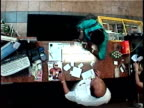 OH MS Security camera view of woman buying scratch-off tickets and scratching them off on convenience store countertop/ woman winning, doing dance and high-fiving clerk/ Brooklyn, New York