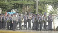 Security forces beat activists protesting in downtown Yangon with batons campaigners and witnesses said Thursday arresting around eight in a surge in...