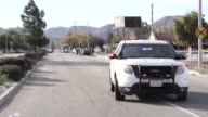 Security Forces secure the area after a mass shooting that killed multiple people at a social services center for the disabled in San Bernardino...