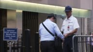 A security guard checks IDs at a checkpoint for workers entering the New York Stock Exchange / Security Check at the New York Stock Exchange on...