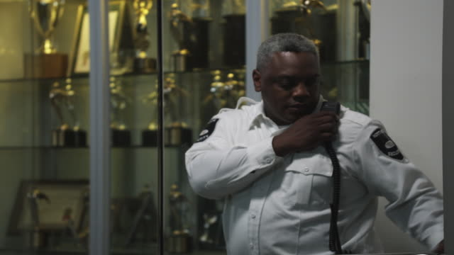 MS Security guard opening door, Dallas, Texas, USA