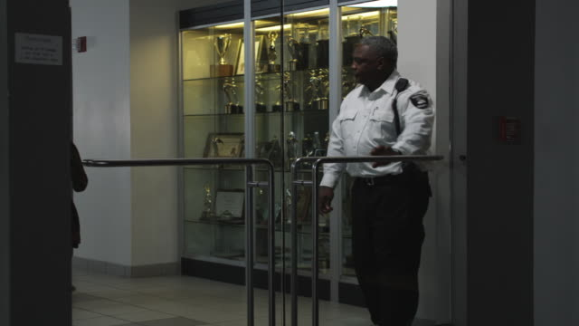 MS Security guard opening door for businessman, Dallas, Texas, USA