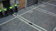 WS PAN Security guard standing on Estafeta street before Running of Bulls Encierro Festival of San Fermin / Pamplona, Navarre, Spain