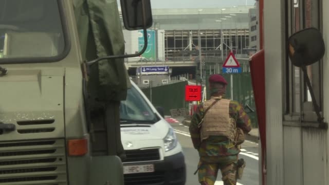 Security guard the area around the exterior of the departure hall of Brussels airport one week after suicide bombs killed 35 people