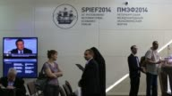 Security guards stand by security scanners at the entrance to the Lenexpo center the venue for the St Petersburg International Economic Forum in...