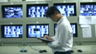 Security man working in CCTV room