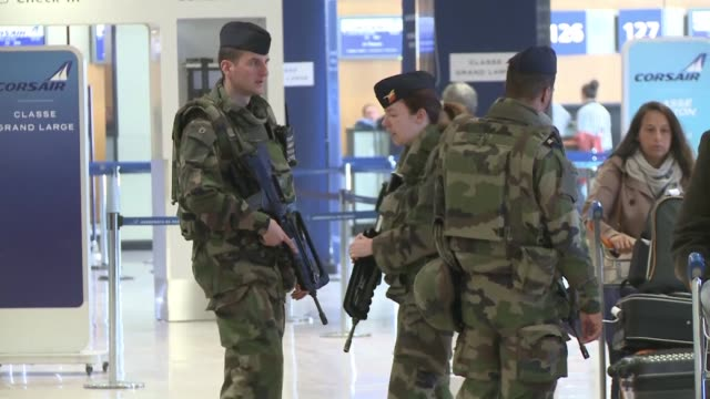 Security measures were reinforced at airports and train stations in Paris and across France following Tuesdays bombings in Brussels with an...
