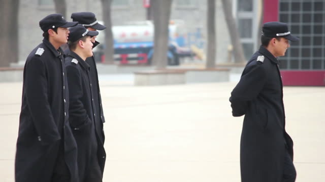 MS TS Security officer gathering on ground / xi'an, shaanxi, china
