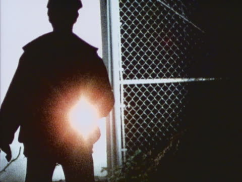 Security officer shining flashlight