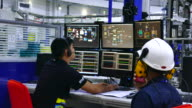 Security officer watching monitoring displays in control room. Security cameras