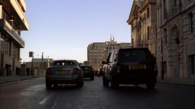 POV Sedan and SUV cutting through traffic on a one-way street