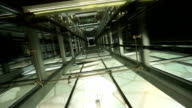 See through ceiling of elevator carriage showing elevator shaft and movement