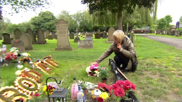 IPCC seeks to overturn own report into the death of Jordon Begley 2013 Grave of Jordon Begley PULL Various of Dorothy Begley laying flowers at her...