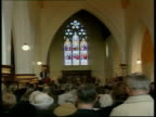 Memorial service C5F BEN ANDO ENGLAND Yorkshire Hensall EXT People into parish church for special church service was held to remember those who died...