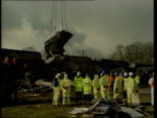 Search for bodies continues ENGLAND North Yorkshire Nr Selby Great Heck Wrecked carriage suspended by crane as being removed from site LA LMS Ditto...
