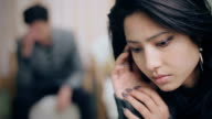 Selective focus on woman, tensed couple facing relationship difficulties.