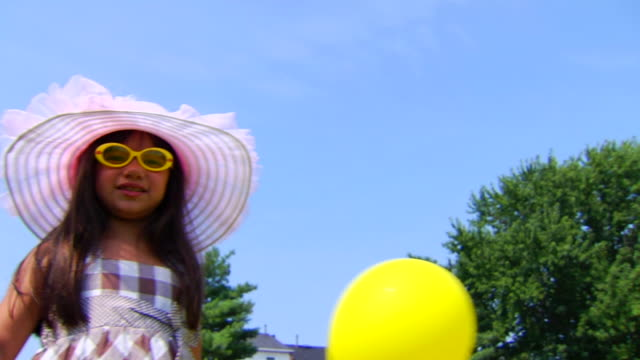 Selena's Glasses and Balloon