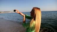 Selfie & blowing a kiss on beach