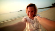 Selfie moment on tropical beach at sunset