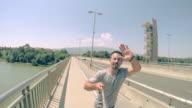 POV Selfie of a man jogging on the bridge