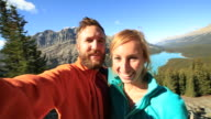 Selfie time in Peyto lake, hiking couple