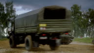 Self-propelled anti-aircraft vehicles on dirt road