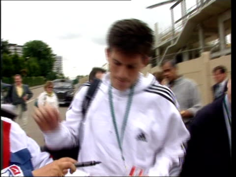 Semi Finals ITN Tim Henman signing autographs and along Henman practising on court next to Pete Sampras