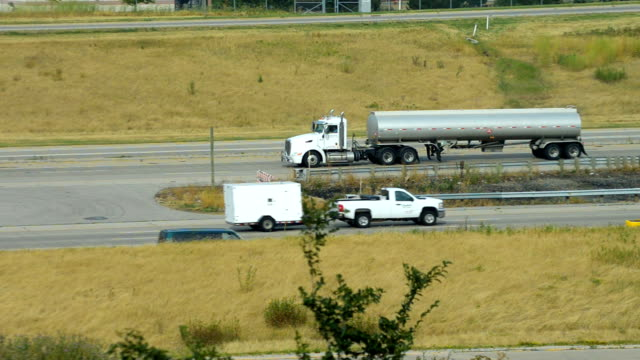 semi with tanker trailer in interstate highway