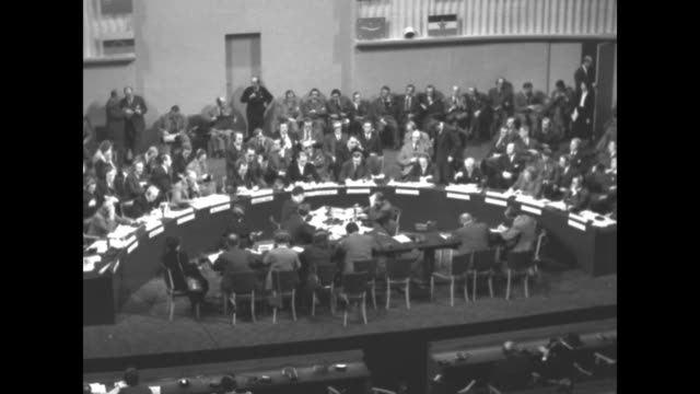 Semicircular group of delegates in at front of room during General Assembly session