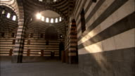 A semi-dome leaves the interior of the Khan As'ad Pasha open to the sky. Available in HD.