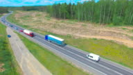 AERIAL: Semi-Trailer Truck Driving On The Road