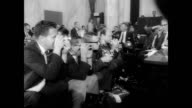 Senate investigation subcommittee hearing in progress investigating Joseph Valachi / Senator John McClellan leads the hearing / press seated in a row...