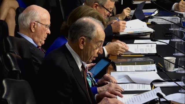 Senate Judiciary Committee Chairman Chuck Grassley of Iowa reads from prepared remarks at the first oversight hearing of the Justice Department with...