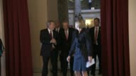 Senate leaders Mitch McConnell and Harry Reid walk together with others to the hall of the House for a Joint Meeting to receive a speech by his...