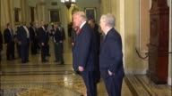 Senate Majority Leader Mitch McConnell of Kentucky escorts with Presidentelect Donald Trump past the press at the Capitol after meeting in his office...