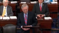 Senate Majority Leader Mitch McConnell of Kentucky speaks on the floor with Senators present after a dramatic vote defeating the Health Care Freedom...