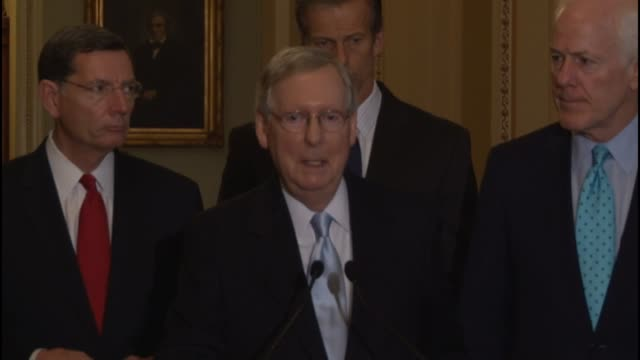 Senate Majority Leader Mitch McConnell of Kentucky takes a question from a reporter about Guantanamo Bay provisions of law expands on a message to...