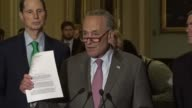 Senate Minority Leader Chuck Schumer of New York begins a weekly press briefing with reporters by describing a letter written by his caucus to...