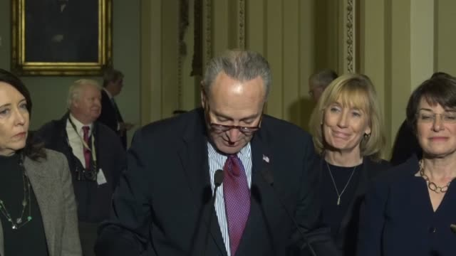 Senate Minority Leader Chuck Schumer of New York opens a press briefing outside the Senate chamber to tell the reporters that Republicans were...