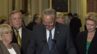 Senate Minority Leader Chuck Schumer opens a press briefing after a very productive meeting with leaders and President Donald Trump at the White...