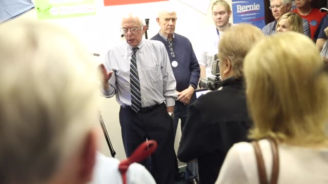 Senator Bernie Sanders greets supporters during a visit to his Iowa campaign headquarters on June 13 2015 in Des Moines Iowa Sanders began a threeday...