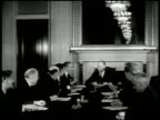 Senator Robert A Taft sitting at head of table w/ Senator Arthur H Vandenberg members talking MS Taft talking Vandenberg listening BG