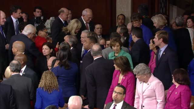 Senators and Congressmen linger before the January 2015 speech begins