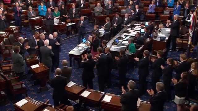 Senators pages and others warmly welcome Arizona Senator John McCain back to the Senate after a diagnosis of glioblastoma to support a motion to...