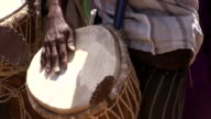 Senegal, Podor, man playing drum