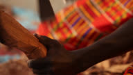 Senegalese craftsman carves wooden ormnament
