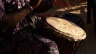 Senegalese man playing Djembe drum
