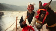Senior Adult Chinese Man with his donkey